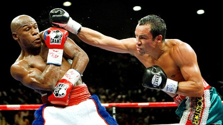 Floyd Mayeather brushes away a right hand from Juan Manuel Marquez during their bout in September 2009.